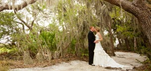 Married Couple Kissing beneath a Tree