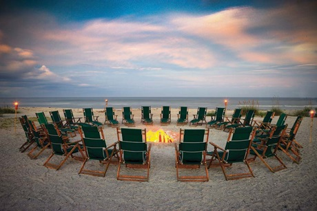 Beach chairs around a fire